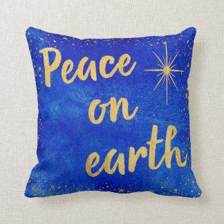 Paz no azul e no ouro do Natal da terra Almofada