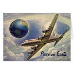 Paz no cartão de Natal do avião do vintage da terr