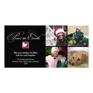 Paz preta da pomba do branco em cartões de natal d cartão com foto