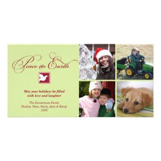 Paz vermelha da pomba do verde em cartões de natal cartão com foto
