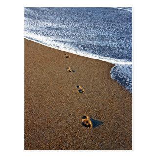 Pegadas na areia cartão postal