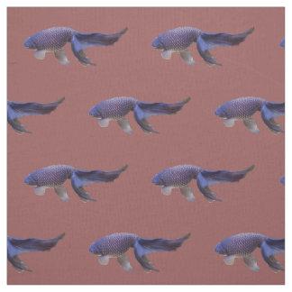 peixes azuis no tecido cor-de-rosa