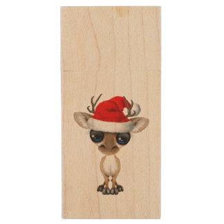 Pen Drive Cervos do bebê que vestem um chapéu do papai noel