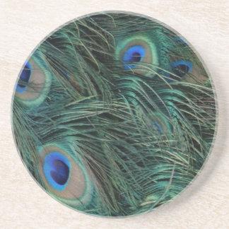 Penas magníficas do pavão porta copos de arenito