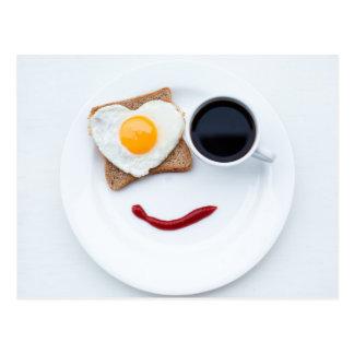 Pequeno almoço feliz da cara cartão postal