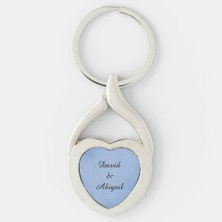 Pergaminho do azul de índigo dos amantes chaveiro coração torcido cor prata