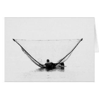 Pescador na simetria cartão de nota