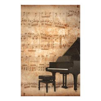 Piano de cauda com notas da música papelaria