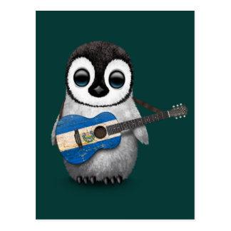 Pinguim do bebê que joga a cerceta da guitarra da cartao postal