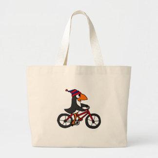 Pinguim engraçado que monta a bicicleta vermelha bolsa para compras