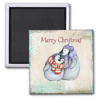 Pinguins de afago bonitos do Feliz Natal Imã