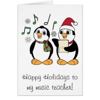 Pinguins do Natal do professor de música que canta Cartões