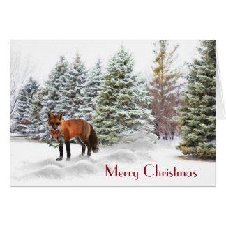 Pinhos nevado com o cartão da natureza do Natal do