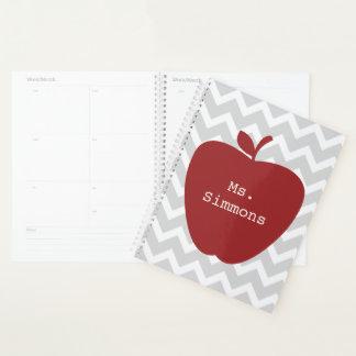 Planejador cinzento vermelho do professor de Apple