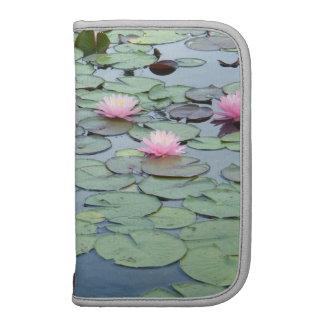 Planejador cor-de-rosa dos lírios de água agendas