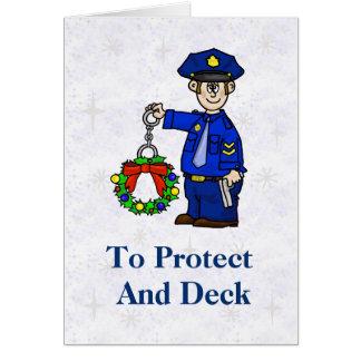 Polícia com o cartão de Natal algemado da grinalda