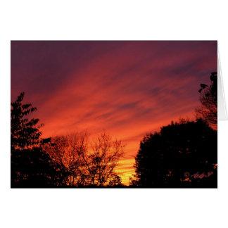 Por do sol antes do cartão do ~ da tempestade