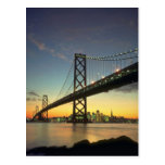 Por do sol bonito: Ponte da baía, San Francisco, C Cartões Postais