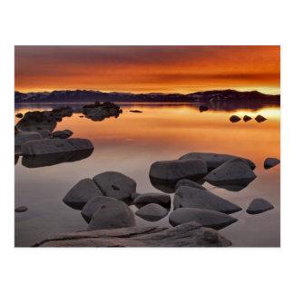 Por do sol da praia do fanfarrão, Lake Tahoe… Cartão Postal