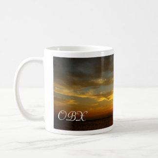 Por do sol no som caneca de café