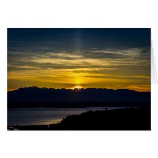 Por do sol sobre o cartão de Seattle