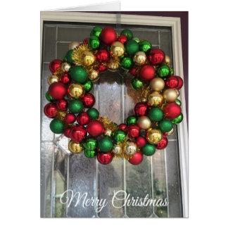 Porta bonito do Natal com o cartão decorativo da