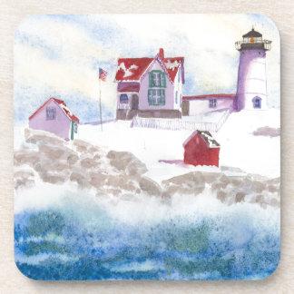 Porta-copo inverno no farol do Nubble em Maine