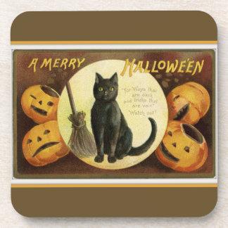 Porta-copo Um gato preto alegre do Dia das Bruxas e abóboras