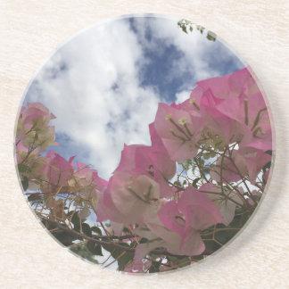 Porta-copos De Arenito flores cor-de-rosa contra um céu azul