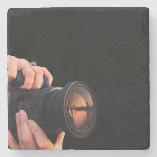 Porta copos de pedra da câmera