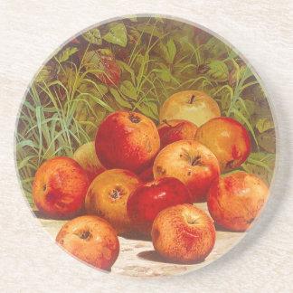 Porta copos do arenito com maçãs