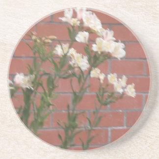 Porta-copos Flores no tijolo
