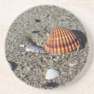 Porta-copos Os Seashells no verão da areia encalham a opinião