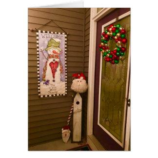 Porta do Natal com o cartão de Papai Noel e de