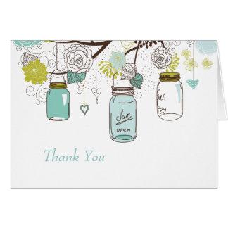 Porte postal azul dos frascos de pedreiro e dos
