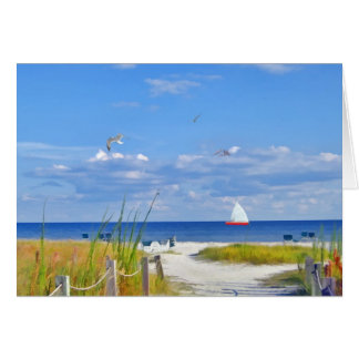 Praia, oceano, e cartão do veleiro