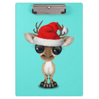 Pranchetas Cervos do bebê que vestem um chapéu do papai noel