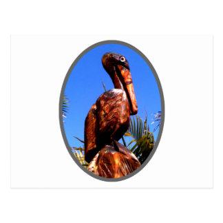 Prata de madeira do pelicano o os presentes de cartoes postais