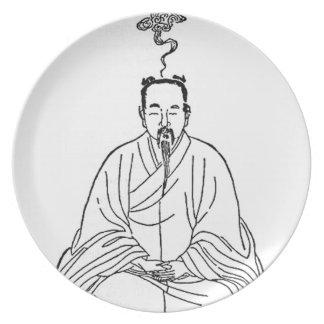 Prato De Festa Homem que senta-se na pose da meditação