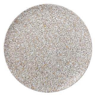 Prato De Festa Lote de pedras cinzentas do cascalho como o fundo