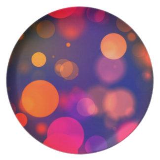 Prato O borrão colorido brilhante de Bokeh do círculo