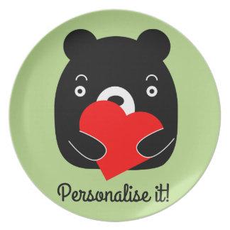 Prato Urso preto que guardara um coração