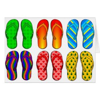 Presentes coloridos do verão do tema da praia do cartão comemorativo