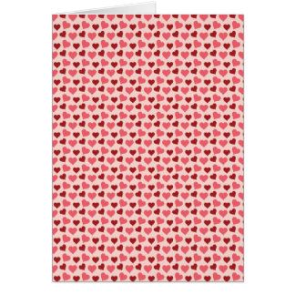 Presentes cor-de-rosa e vermelhos do teste padrão cartão comemorativo