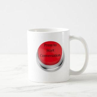 Pressione para ligar a caneca de café da