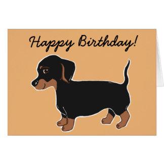 Preto e cartão do feliz aniversario do Dachshund