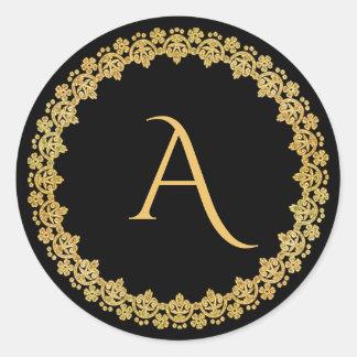 Preto e etiqueta do monograma do Natal do ouro