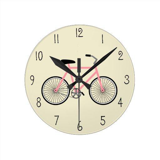 Pulso de disparo cor-de-rosa da bicicleta relógio de parede