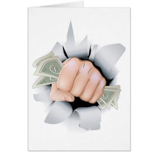 Punho do dinheiro que quebra através da parede cartao