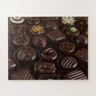 Quebra-cabeça da foto dos doces de chocolate